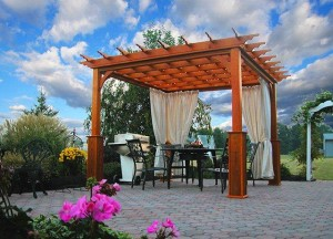 A pergola on a paver patio